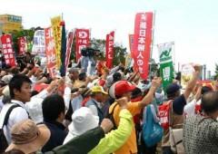 Demonstrators protesting the deployment of MV-22 Osprey aircraft blocked the gates to MCAS Futenma on Sunday