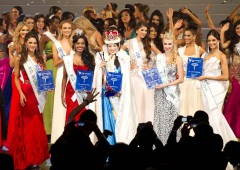 Winners of Miss International Beauty Pageant smile among their co-contestants after the final event at Okinawa Budokan.