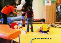 Children&#039;s play area is prepared with toy snakes and other items related to the reptiles.