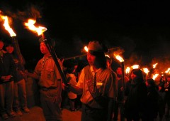 Various youth groups like the Boy and Girl Scouts take part in the ceremony in torch carrying procession.