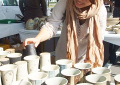 A customer checks handmade teacups during the previous fair.