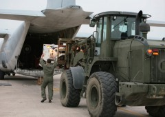 Marines load a KC-130J Hercules aircraft at MCAS Futenma bound for the Republic of the Philippines, Dec. 8, to assist in humanitarian assistance and disaster relief efforts in the wake of Typhoon Bopha. (U.S. Marine Corps photo by Lance Cpl. Matthew Manning)