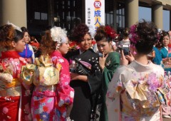 Young ladies on their big day, donning their best kimonos and most fashionable hairdos, as they gather in front of Okinawa City Office on last year's Coming of Age Day.