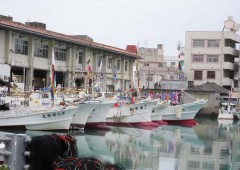 Fishermen in Itoman Fishing Port celebrate the Lunar New Year flying colorful flags on their boats.