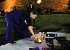 Syusui Taba creating one of her giant calligraphy pieces during an event at Nakijin Castle site.