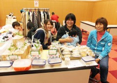 Goods ranging from homemade foods to used clothes fill the tables at the flea market.
