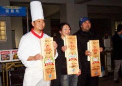 Winners of last year's contest line up to show their certificates at Onoyama Athletic Park.