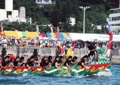 Powered by crews of up to 40 rowers the boats race the 4 x 100-meter long Naha Haarii course.
