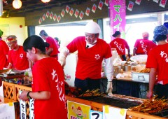 "Cooks from nearby Mahaina Hotel man the food stalls at ""Mahaina Yatai Mura"" that is specifically set up for the festival."