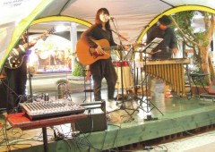 Musicians play on several stages set along Chuo Park Avenue in Okinawa City.