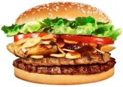 Burger King Japan believes their customers can beat the heat with the help of their Garlic Meat Monster, a burger worthy of Gozilla himself. It will be on the menus of Japanese Burger Kings starting Friday.