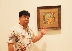 Jimmy Onishi introduces one of his colorful works,