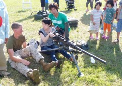 One of the biggest attractions of base festivals are exhibitions of military hardware; everyting from machine guns and howitzers to aircraft interests local visitors, and there is no lack of willing experts happy to explain. (MCCS photo)