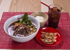 A bowl of hot ramen is the quintessential Japanese fast food meal, often accompanied with with a couple of gyoza dumplings.