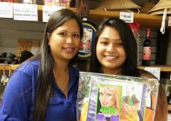 Vina Salas (left) with her daughter smile with their prize of Hallo-ween goods.