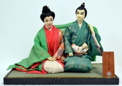 A Ryukyu couple in traditional garb is typical of Tokumura's works.