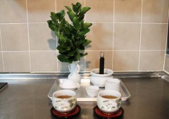 Hinukan is usually a simple arrangement of tea, rice, ash, a cup for awamori and a vessel to burn an incense stick a couple of times a month in some corner of the kitchen,