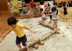 Children like to play with wooden toys.