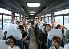 Participants on Japan Update~Golden Kings Bus Tour on the way to enjoy the game and friendships.