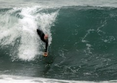 Hand plane surfer Bryan Dean Amicone enjoys a ride.