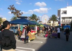 Booths selling handicrafts and used American items line the Akara Gallery parking lot this weekend.