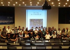 "2013 Blue October participants from both the Okinawa NGO Asia-Pacific Environmental Forum and the UNEP Regional Seas Programme's Northwest Pacific Action Plan (NOWPAP) workshop participants in Onna Village (OIST Lecture Hall). The screen behind reads: ""My Island: My Earth"" Charter. Wookblock print by Naka Bokunen."