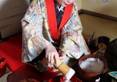 Hatsuko Nakasone shows the right way to serve the traditional Okinawan Buku Buku Cha.
