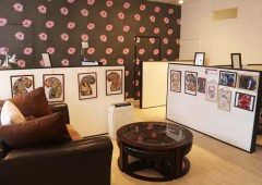 The customer lounge at the shop features comfortable sofas and a collection of pictures of various-style tattoos, although customer requests are also most welcome.