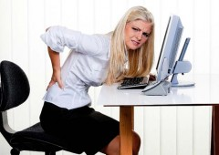 Sitting hours on end can result in back pain.