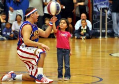 The Harlem Globetrotters are always ready to teach some basketball tricks to appreciative audience.