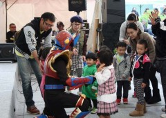 Local children greet super hero Urumaa.