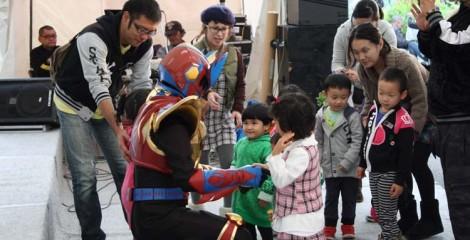 Local children greet super hero Urumaa.