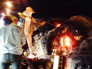 Pottery artisan trending his kiln in Zakimi, the center of Yomitan pottery industry.