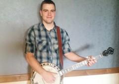 Banjo player Heyden Reynolds performs at Geien Saturday.