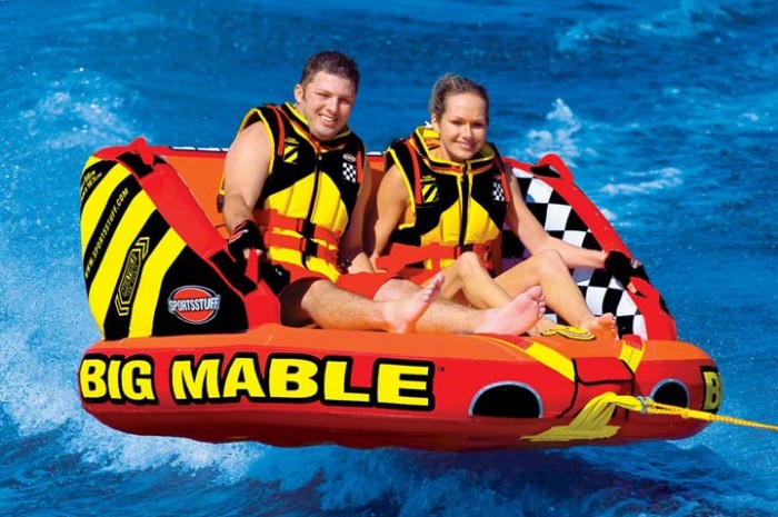 Kin Blue Beach Bash goers can enjoy thrills on a Mable inflatable and try wakeboarding.