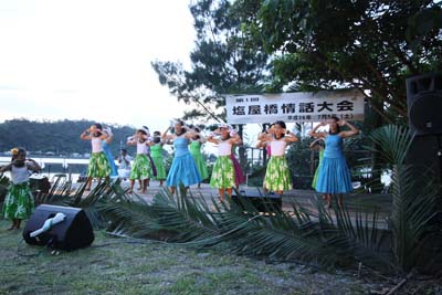 Local groups entertain visitors with hula and other performances.