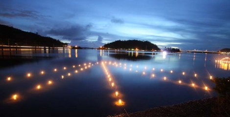 Shioya Bay shores are lit with some 4,000 candles this Saturday evening.