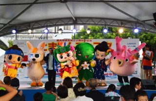 Outer islands' mascot characters introduce their respective homes to the audience during the festival.