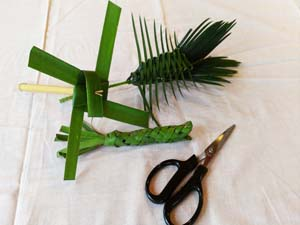 A workshop teaches participants how to make traditional OKinawan children's toys from natural materials.