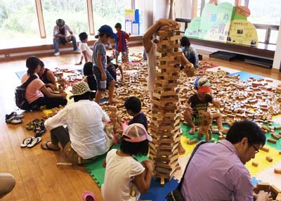 A playground featuring all-wooden toys is popular among kids.