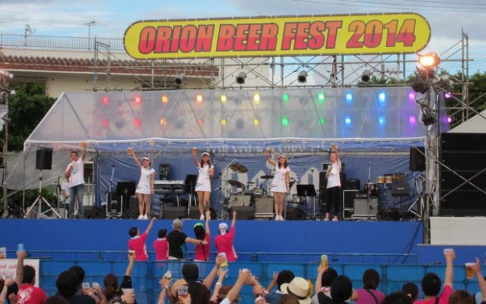 Orion campaign girls lead the toast from stage at last year's Orion Beer Fest.