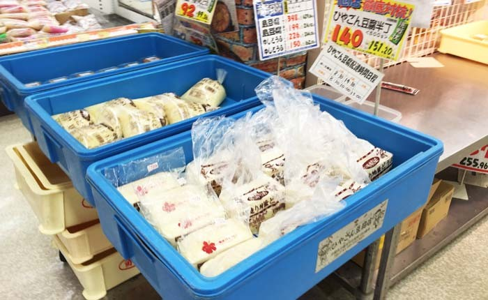 Tofu from various makers on display at a local supermarket.