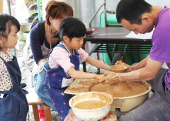 Visitors have a chance to try their hand at potters' wheel.