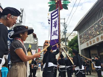 Local youth group shows their skill at handling a 'hatagashira' pole.