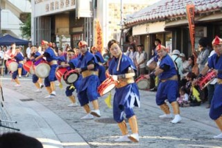 Eisa dancers perform on Yachimun Street in Tsuboya, Naha City.