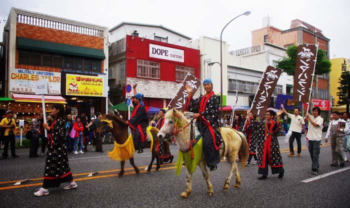 Okinawa City 'Uma Harase' horse racers in parade.