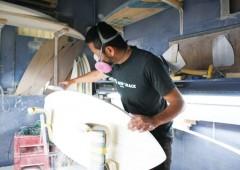 Mamoru Itokazu shapes a surfboard in his shop M's Surfshack.