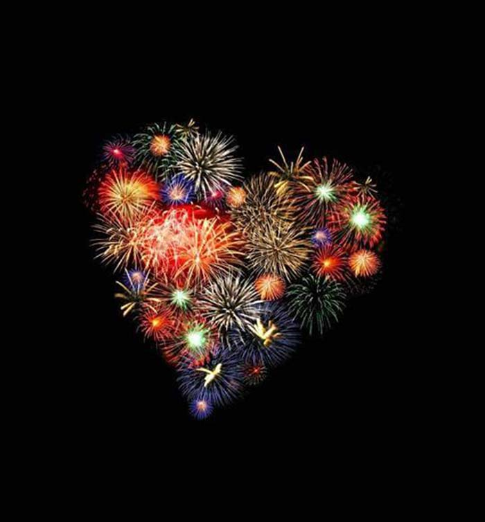 Fireworks launched just right form a heart, the symbol of Uruma City.