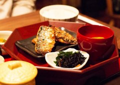 A typical 'washoku' meal consists of a cup of rice, bowl of miso soup, and side and main dish, in this case fried mackerel.