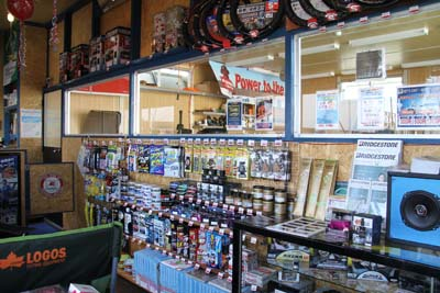 A selection of accessories, oils and waxes are offered from the shelves, and customers can do all work if they so choose.